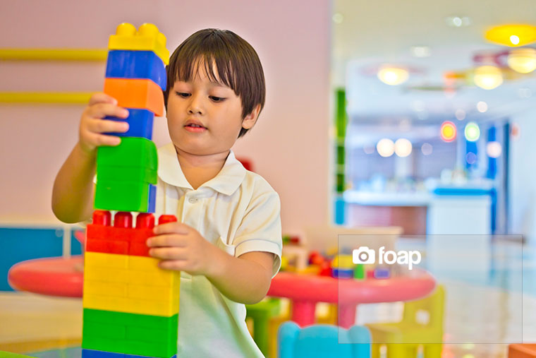 Foap-Young_boy_building_tower_with_colorful_bricksw