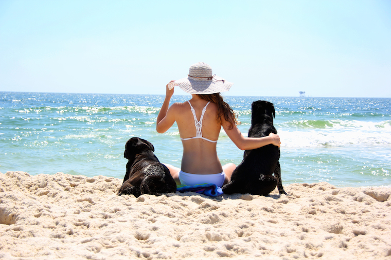 Foap-Girl_on_a_beach_with_her_dogs