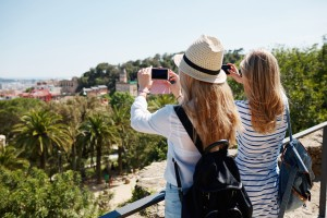 Foap-Couple_tourists_taking_photo_landscape_with_camera_phone_on_park__Happy_cheerful_young_multicultural_couple_friends_on_travel_ (1)