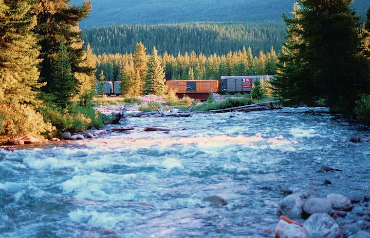 Foap-Train_crossing_River_in_Forest