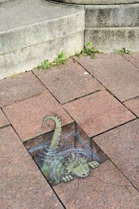 dinosaur in pavement copy